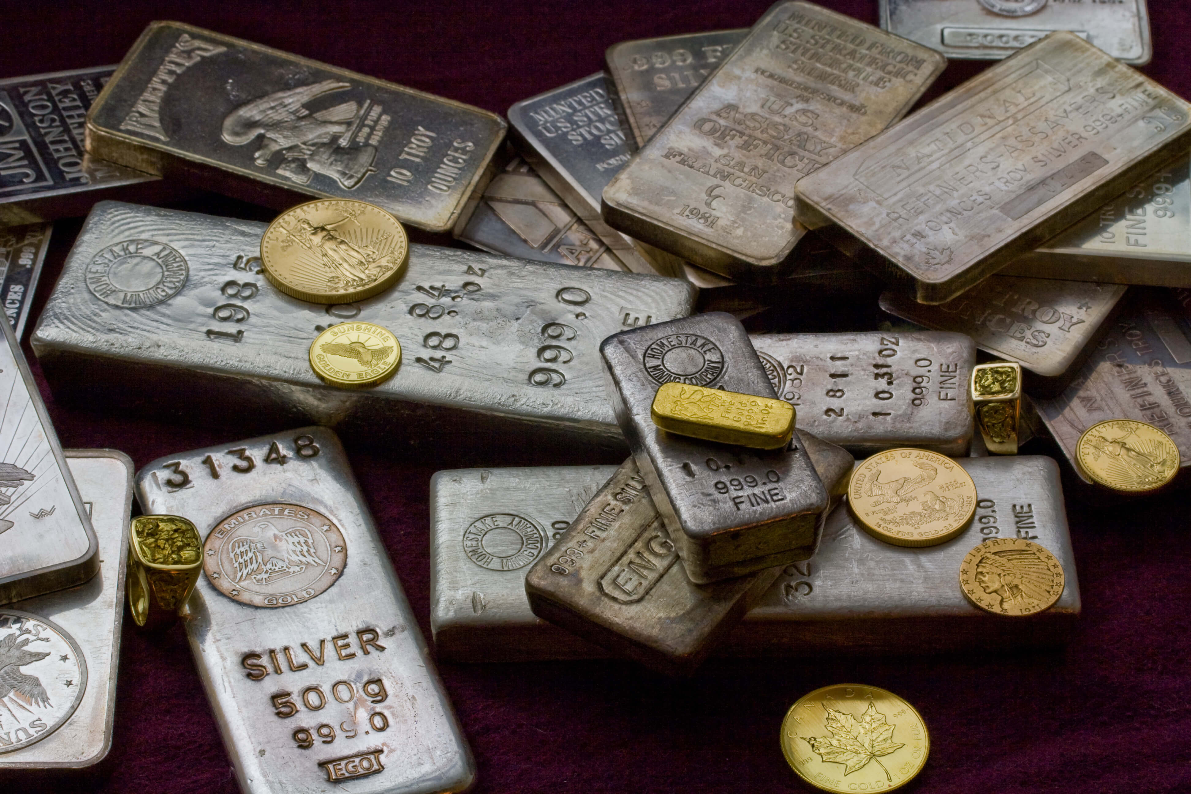 Gold and Silver Bullion on table
