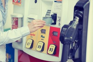 Hand in front of gas pump