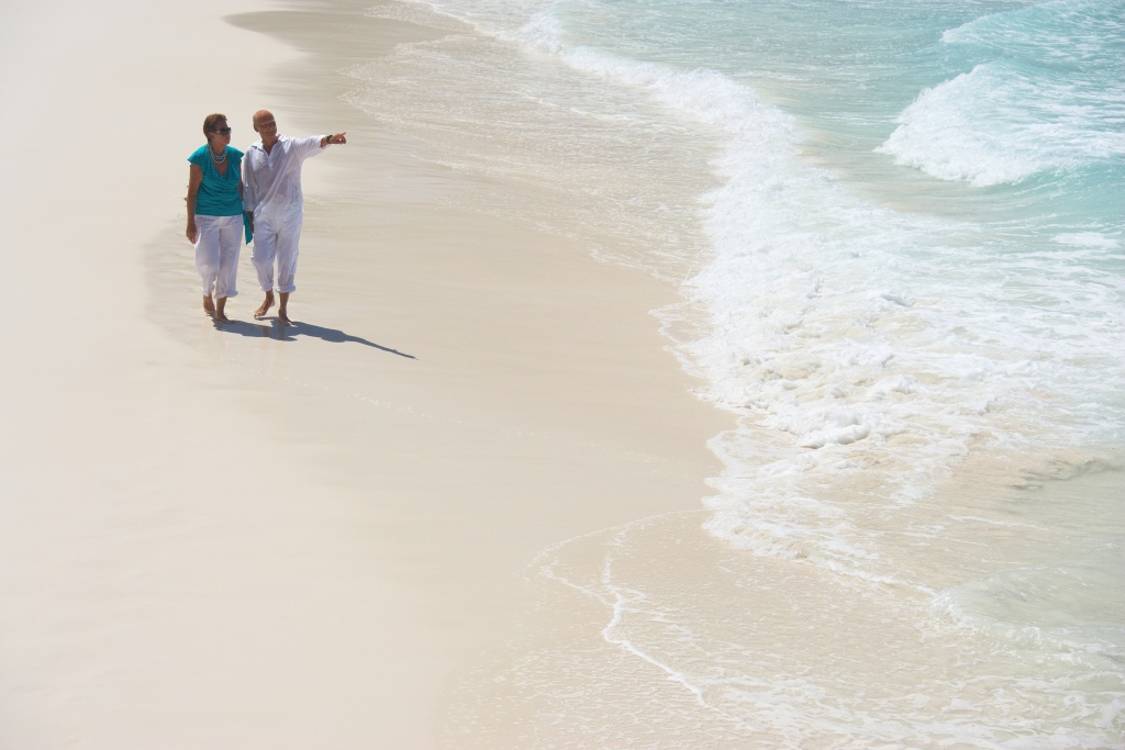 baby boomer couple on broad sandy beach